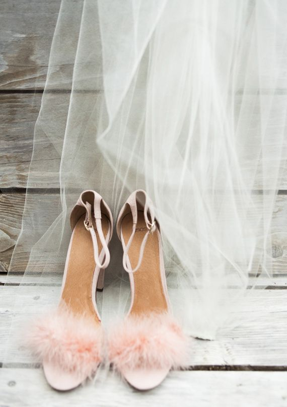 Three elements to perfect romantic wedding day style: pink, feathers, organza.