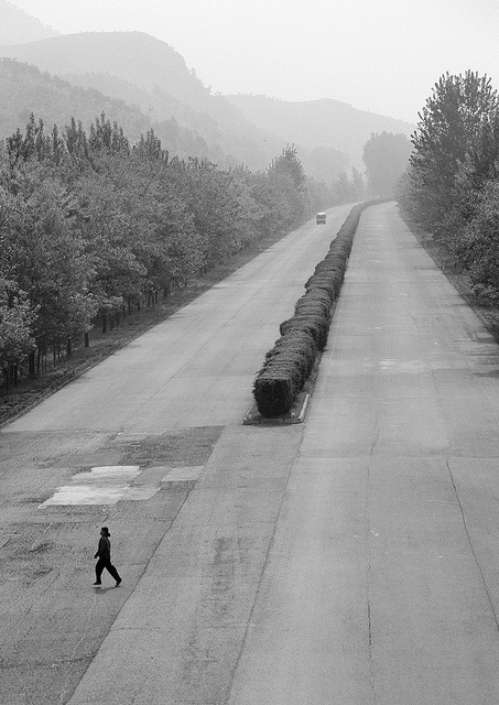 Highway in North Korea- only a tour bus which show a fantasied NK to Tourist is on the road