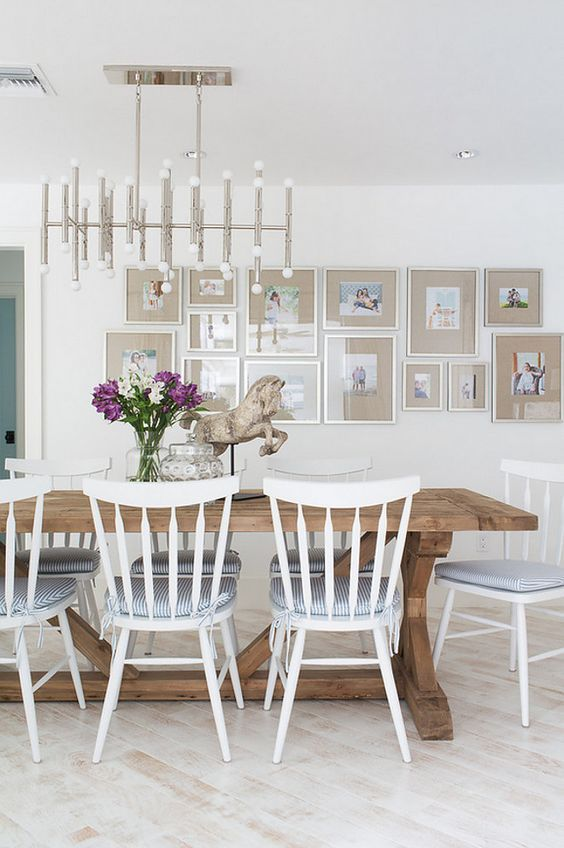 Dining Room Gallery Wall: Picture frames are from West Elm. Lighting is Robert Abbey Jonathan Adler Meurice Chandelier, Polished Nickel – $1600 Table is Restoration Hardware. Lischkoff Design Planning. Michelle Peek Photography.