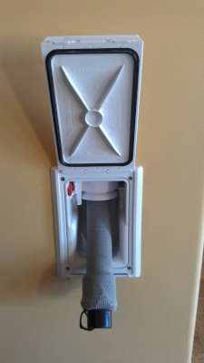 Central Vacuum system that hides the hose in the wall. -Just pull it out to use it. Retract when done. Genius.