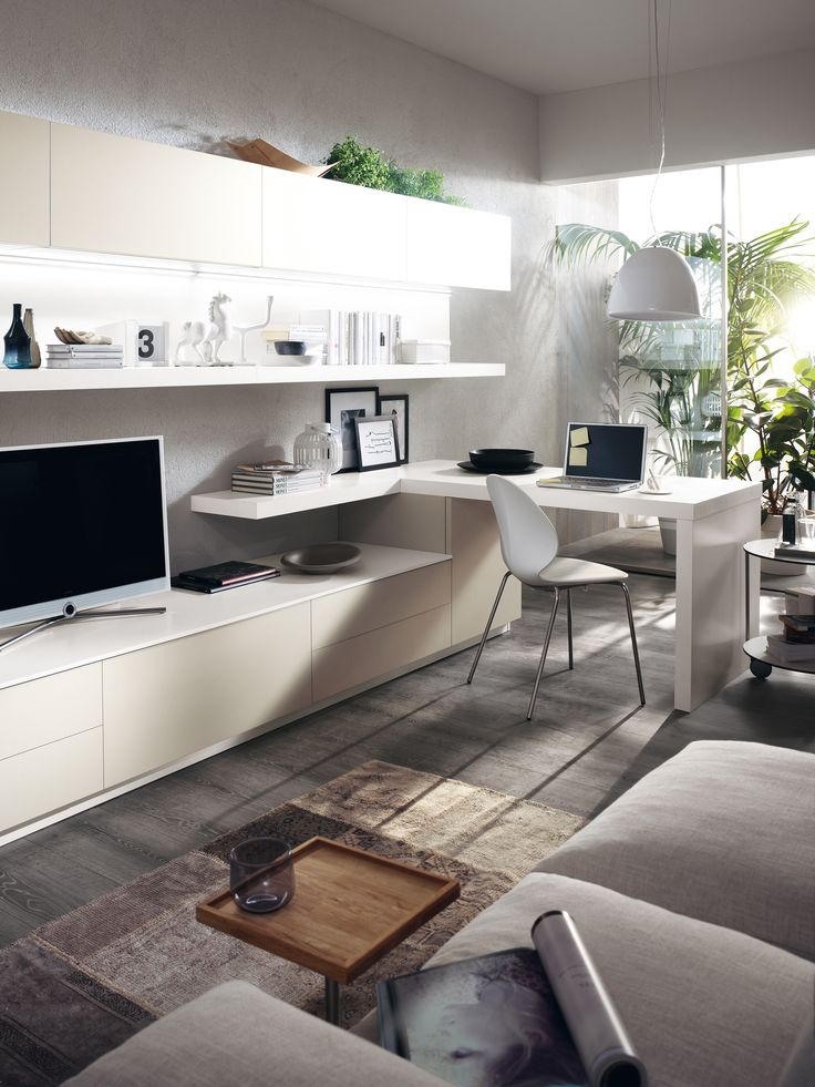 A large #living area offering a relaxation zone that also includes a desktop for study | #Design by #Scavolini