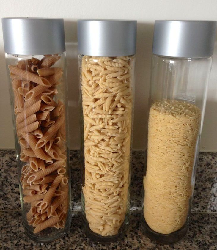 Put Empty Water Bottles To Good Use VOSS and other glass water bottles are perfect kitchen storage options for beans, nut flours, stevia/coconut sugar and other dry goods.