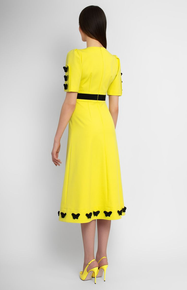 Yellow stretchy cotton dress decorated with lace butterflies and ribbon. V-neck with deep neckline. Hidden back zip closure. Without pockets.