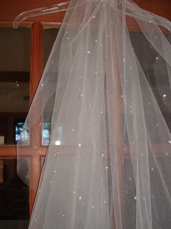 veil made for champagne dress.  It goes to the floor and the blusher is attached with clear snaps; therefore; you can take off the long veil for the reception.  The champagne wedding tulle illusions comes with scattered crystals.  It is 2 pieces tacked in the middle with clear thread.