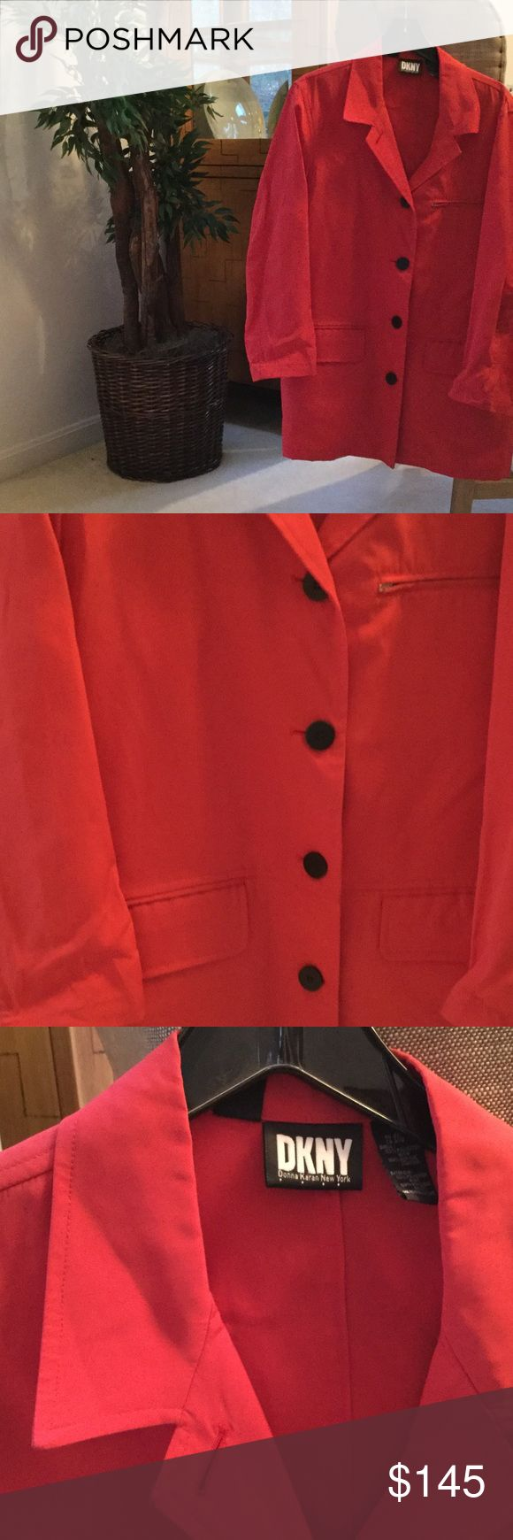 Ladies red nylon spring 3/4 rain jacket M Ladies DKNY spring weight 3/4 length nylon raincoat with large black buttons. Great for spring and fall when you want a little pop of color over black ,brown, navy ...really any color.  Barely worn a time or two...does have small almost unnoticeable mark on lower back . Would come out with dry cleaning DKNY Jackets & Coats