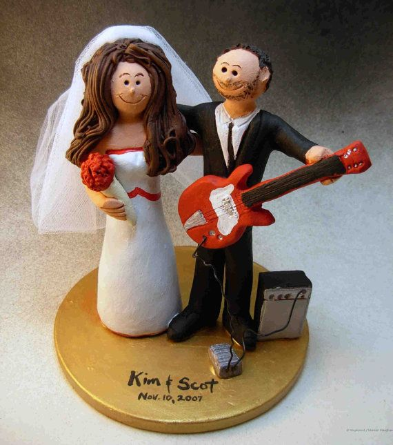 Rock n Roll Bride and Groom CakeTopper    Wedding Cake Topper for a Rock and Roll Guitar Player, custom created for you! Perfect for the marriage of a Rock Star Guitar Groom and his Bride!    $235   #magicmud   1 800 231 9814   www.magicmud.com