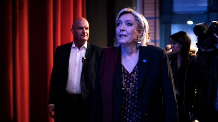 This file photo taken on February 04, 2017 shows French presidential election candidate for the far-right Front National (FN) party Marine Le Pen (C) arriving to attend a two-day political rally to kick off her presidential campaign next to her aide Catherine Griset (3rd-L) and bodyguard Thierry Legier (1st-L) in Lyon.