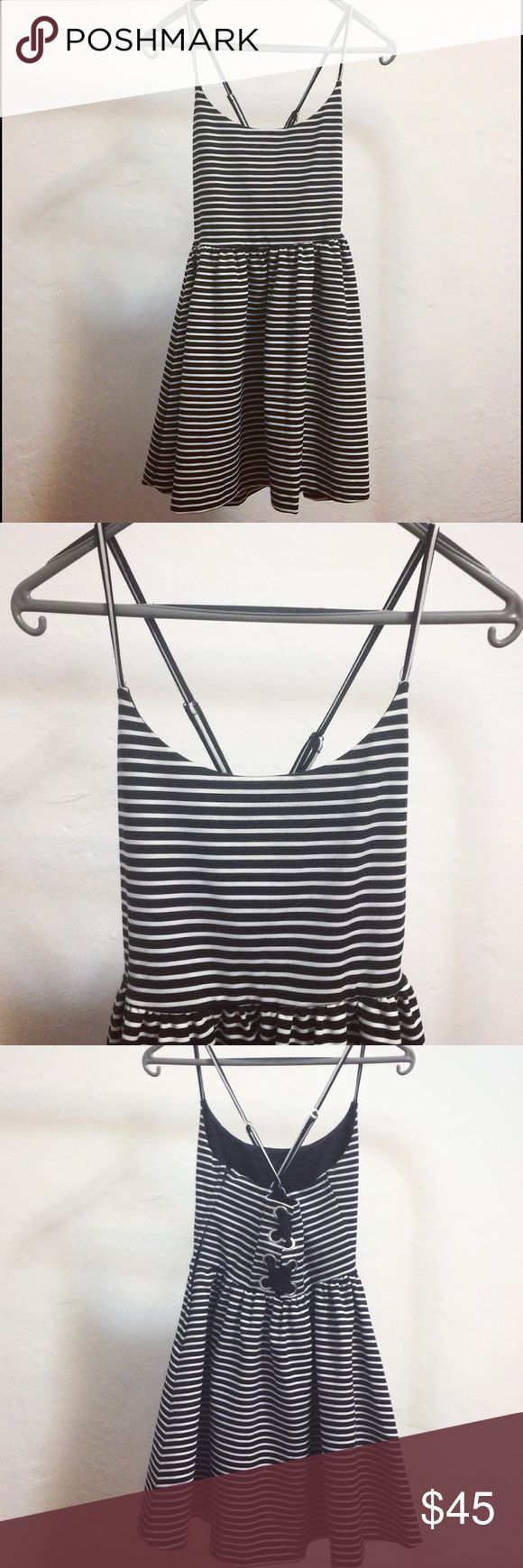 B&W Guess dress Guess Los Angeles dress size 6 ••• great condition ••• crossback straps that are adjustable ••• super cute dress you can wear for multiple occasions (would go perfect with a black sun hat and some dark shades) 🕶 Guess Dresses Mini