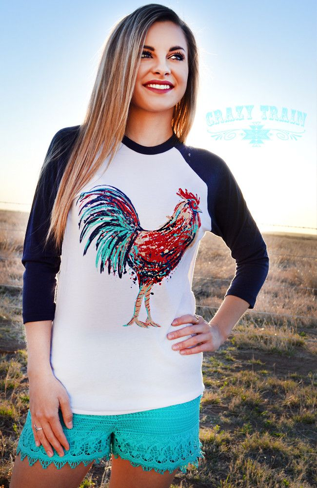 This colorful rooster has turquoise feathers! Another great shirt from Crazy Train. Add this one to your casual collection! SMALL: 4/6 MEDIUM: 8/10 LARGE: 10/12 XL: 14/16 XXL: 18/20