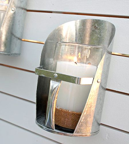 Turn vintage feed scoops into nice outdoor candle holders.
