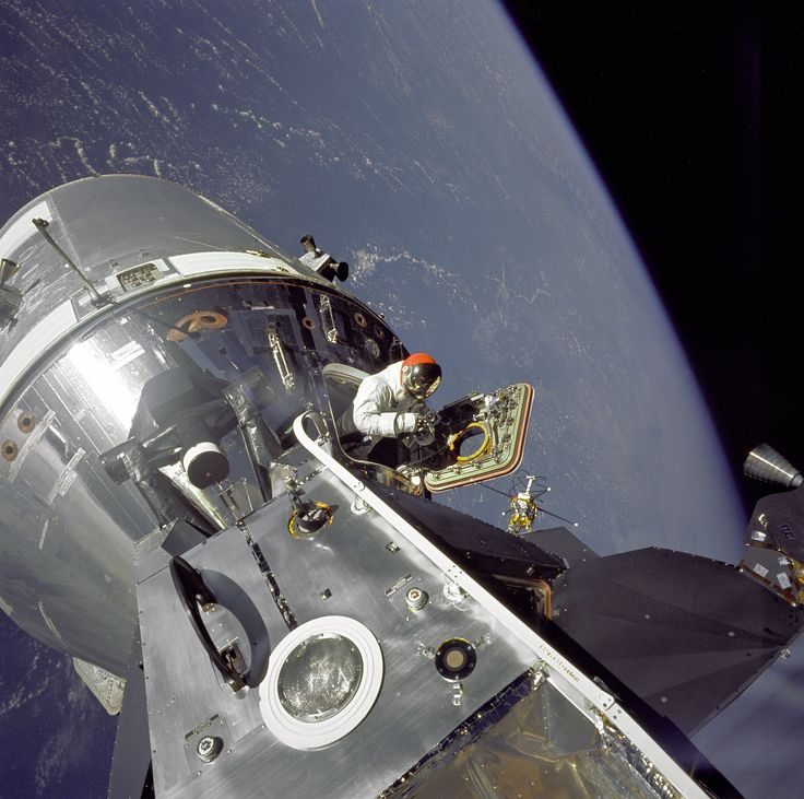 "The Apollo 9 Command/Service Module (CSM), nicknamed ""Gumdrop"", and Lunar Module (LM), nicknamed ""Spider"", are shown docked together as Command Module pilot David Scott stands in the open hatch (March 6 1969) [3020x3000]"
