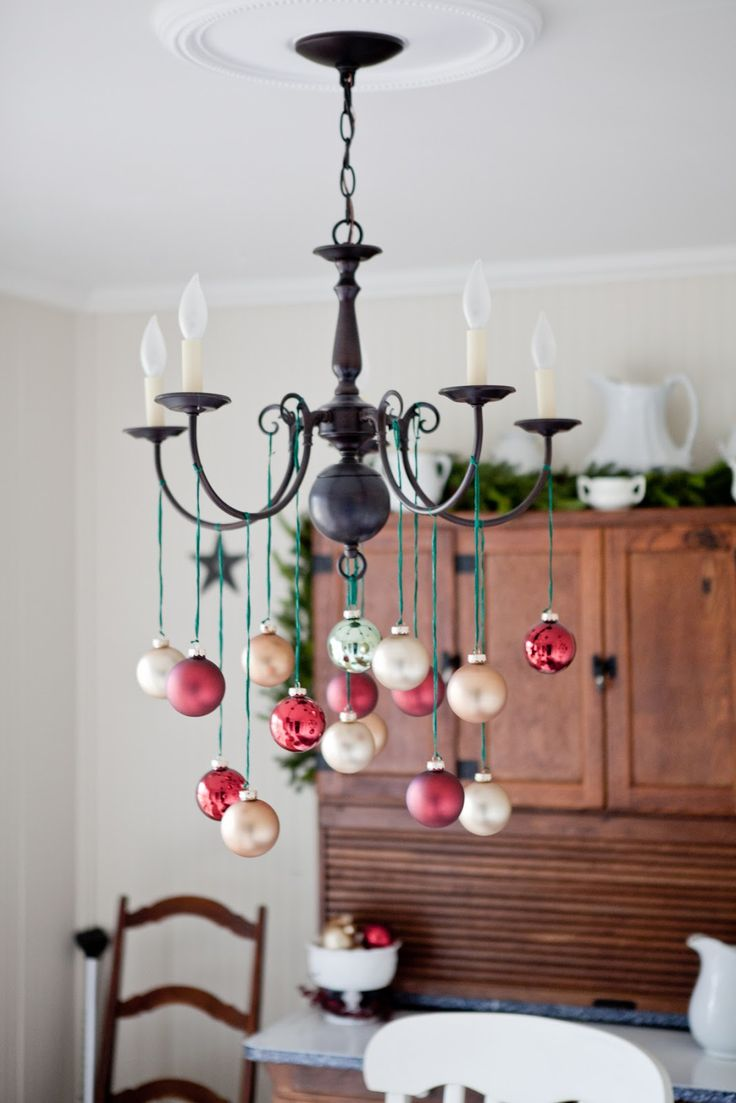 I happen to own this exact same chandelier. I guess this means I have to hang Christmas decorations from it.