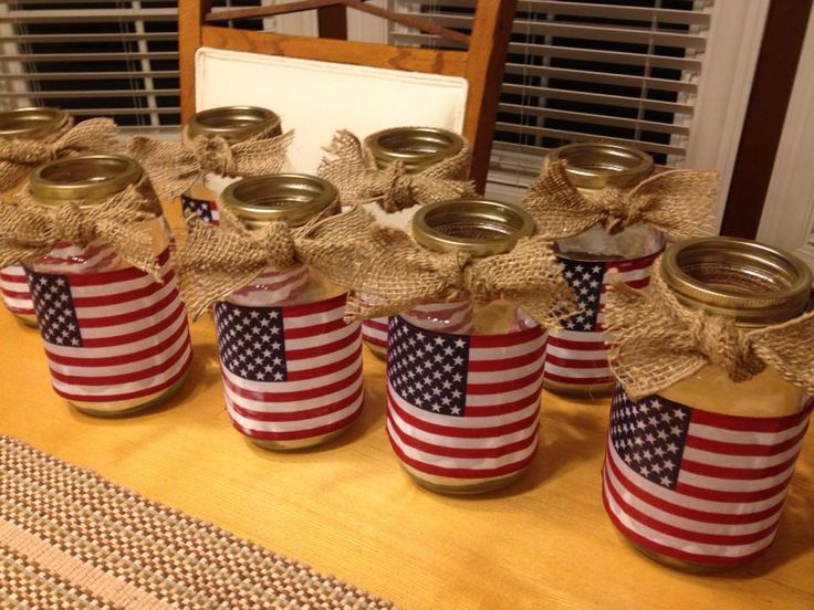 Modge Podge flags onto mason jars for a cute candle holder.  Burlap makes it!