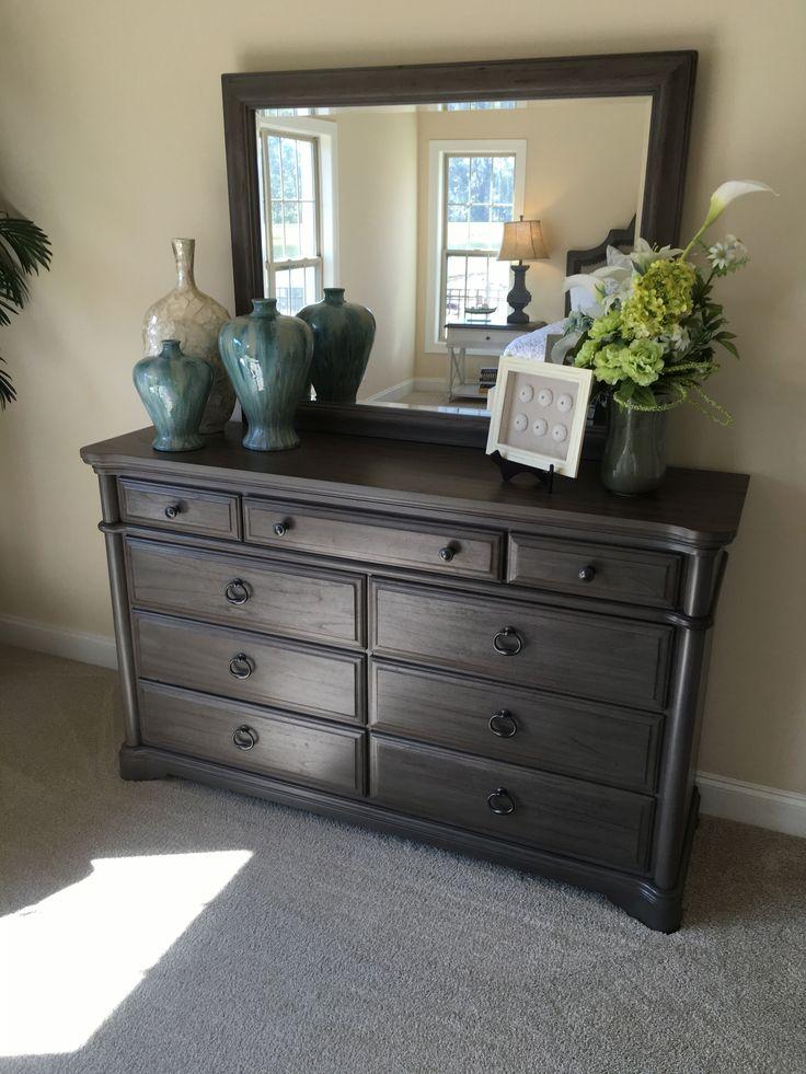 How to stage a bedroom dresser with vases urns frames