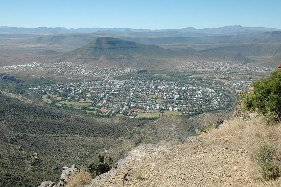"""View of Graaff Reinet from Valley of Desolation  The Wonder Of Graaff-Reinet    In the heart of the Camdeboo National Park lies the picturesque town of Graaff-Reinet, home to over 220 national heritage sites, more than any other town or city in South Africa. Graaff-Reinet is found in the Karoo, a name which means """"Place of Thirst"""", however as part of the Camdeboo National Park Graaff-Reinet is blessed with an abundance of water in the form of lakes, streams and rivers.    The abundance of…"""