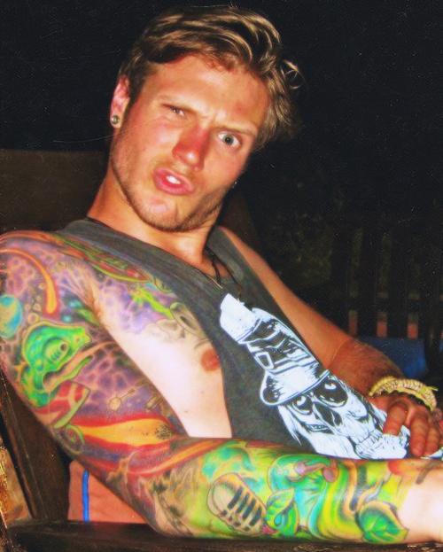 Loving all his tattoos.