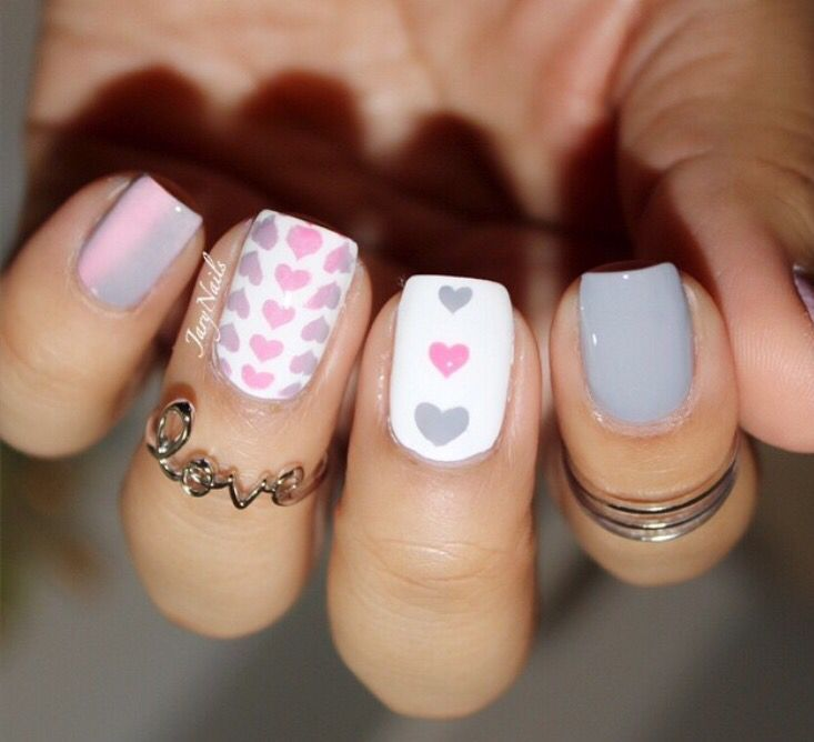 Grey pink and white love heart nail art.