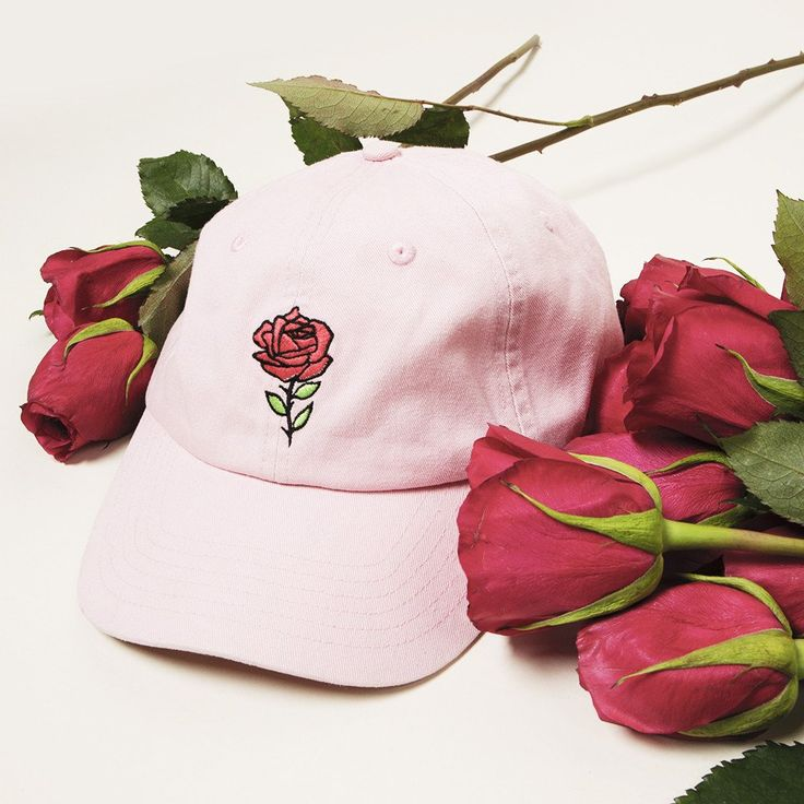 In bloom This classic fit pink snapback hat features an embroidered red rose.  Features an embroidered red rose Adjustable back strap with metal closure...