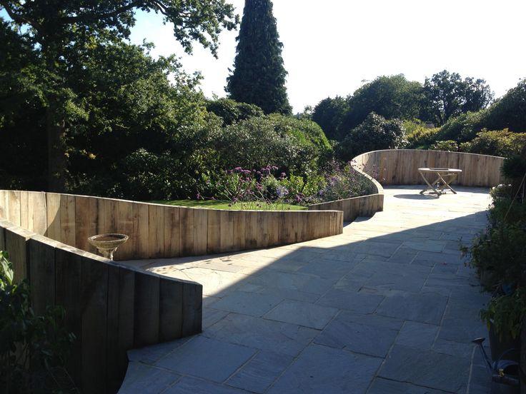 Best 25 oak sleepers ideas on pinterest sleeper table for Curved garden wall ideas