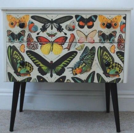 butterflies on a chest of drawers