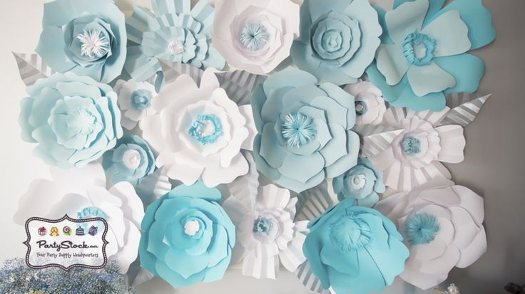 Cinderella Themed Birthday Party Ideas. Check out the paper flower backdrop. Shop decorations and supplies at www.partystock.ca