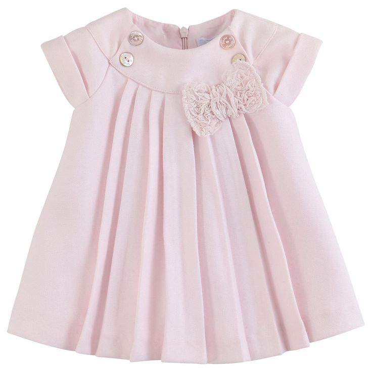 Pleated dress made of light pink flannel. Synthetic lining with Tartine & Chocolat logo print. Short sleeves. Zip fastening at the back. Front trimmed with a large lace bow and buttons.