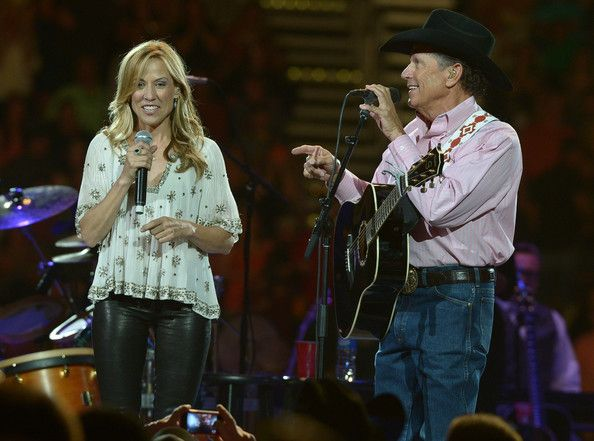 George Strait Photos Photos - Sheryl Crow joins George Strait and performs during The Cowboy Rides Away Tour at Philips Arena on March 22, 2014 in Atlanta, Georgia. - George Strait and Sheryl Crow