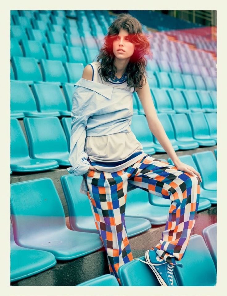 Anthonina Petkovic models asymmetrical top and multi-colored pants by Emilio Pucci