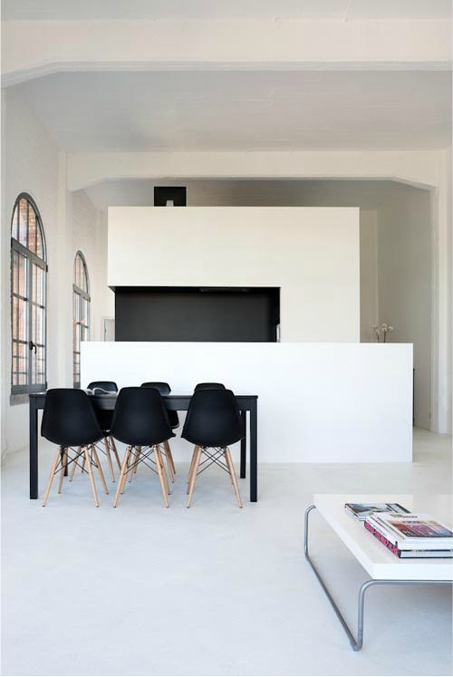 Paired back, almost austere feeling. Black Eames DSW dining chairs. #Kitchen #Dining