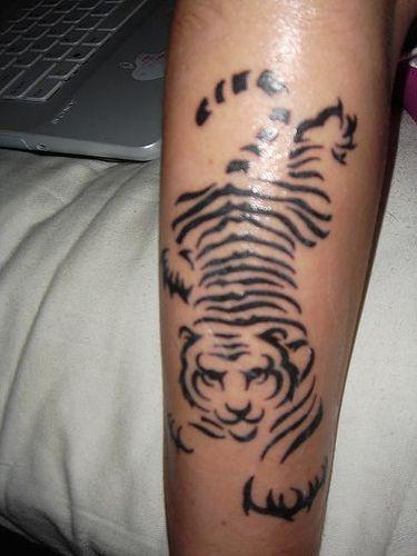 http://makinbacon.hubpages.com/hub/Awesome-Tiger-Tattoos