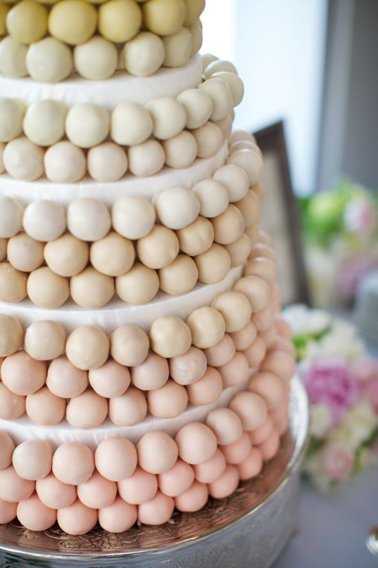 Instead of a wedding cake, a tiered concoction of cake balls.  Cool.