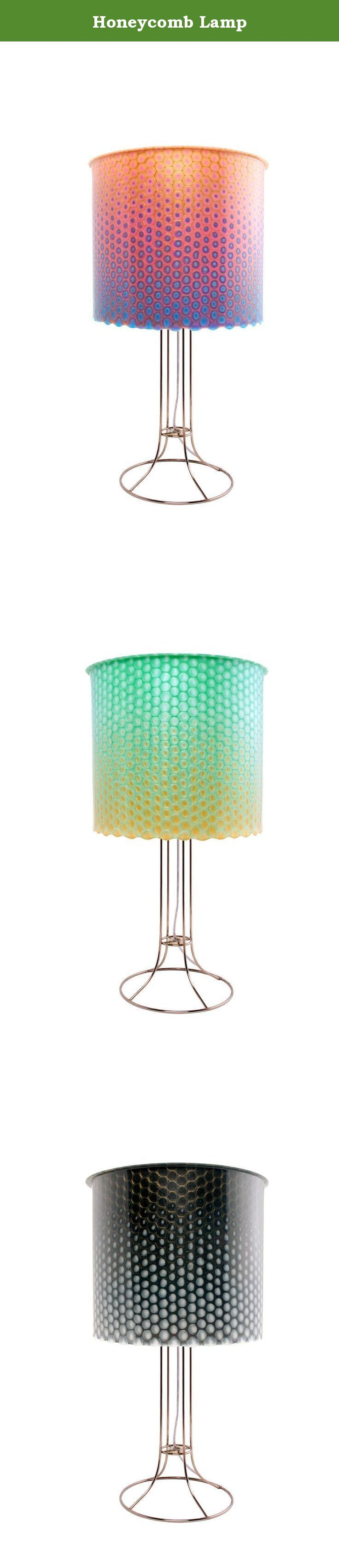 Honeycomb Lamp. The beautiful array of cell-like structures with a luscious center of metamorphosing color. How could bees be wrong! Our techniques for layering color neutralize the sterile effect of compact fluorescent bulbs, instead emoting a light that is warm and inviting, making high efficiency bulbs the ideal and responsible choice. We have mastered a combination of elegance and efficiency.