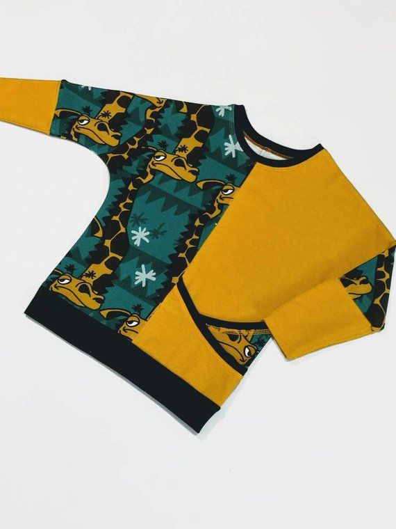 25a81cbc Organic Giraffe print and mustard yellow geometric styled pocketed top for  babies, girls and boys.