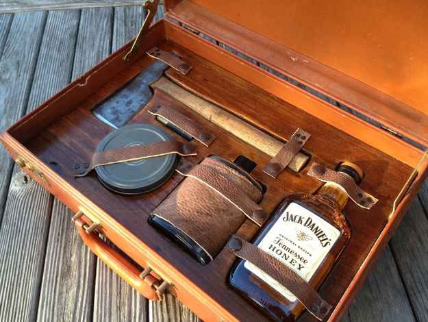 Gentleman's Survival Kit- complete with whiskey, a match tin, hatchet and a leather covered flask