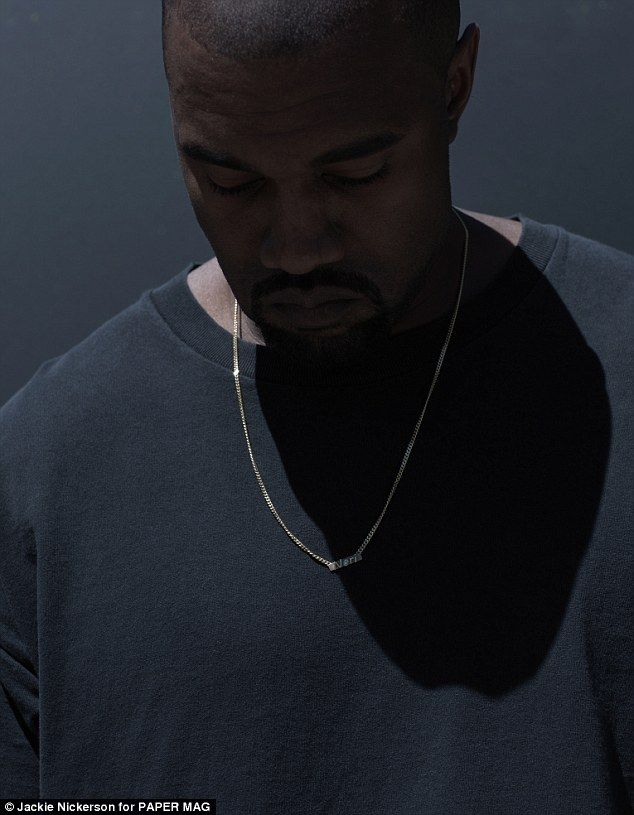 Proud dad: The father also wore a necklace featuring his daughter North's nickname, Nori...