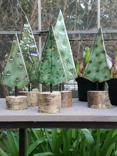 YARD IDEA...Use real cut logs...top with mini trees!  Or use wood pallets to make tree on top...