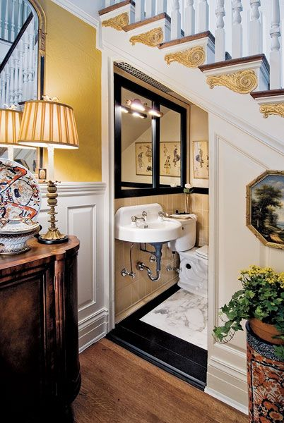 Wonderful guest bath tucked under the stairs. Love the rich gold with the black and white accents.     Try: Benjamin Moore Yellow Topaz http://www.myperfectcolor.com/en/color/378975_Benjamin-Moore-CSP-945-yellow-topaz    design Joan Picone in Green Village via DesignNJ