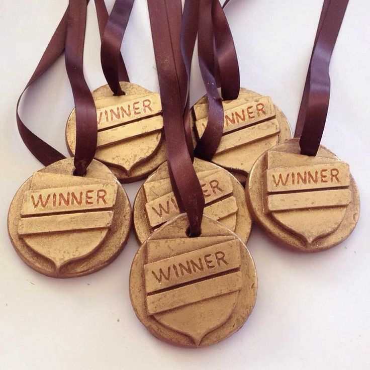 Chocolate+Gold+Medals+-+If+you've+been+swept+up+in+the+excitement+of+Rio+2016+and+fancy+your+own+haul+of+gold+medals,+then+look+no+further. Great+for+a+party,+Sports+Day+or+the+Olympian+in+your+life,+each+of+these+six+milk+chocolate+medals+is+dusted+in+gold+and+strung+on+a+brown+satin+ribbon.+Go+on,+take+a+bite...  Handmade+from+milk+Belgian+chocolate Contains+six+chocolate+medals+on+brown+satin+ribbon Shelf+life:+1+year+(if+you+can+resist) Gluten-free Decorated+with+edible+golden+gli...