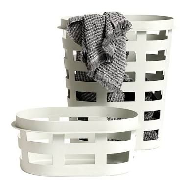 Laundry basket in light grey by Hay | This simple yet stylish laundry basket is both versatile and stackable. It's narrowness is great for small spaces and even little nooks that can't fit much else. #laundrybasket #scandistyle #minimalist #storage #storafebasket #homewaresstation