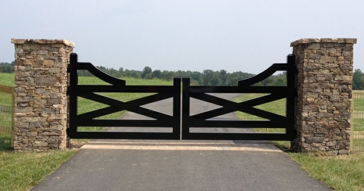 Custom design and fabricated out of aluminum to look like wood. Entrance to a big farm.