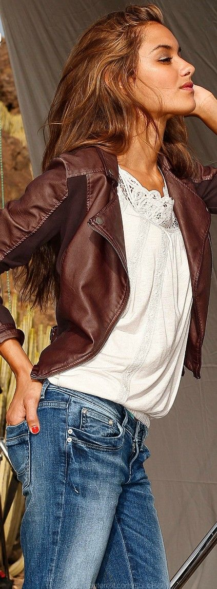 chocolate brown leather jacket with a white lacy tank