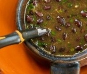 Minus the ham! Spicy black bean soup with cilantro and green Tabasco.