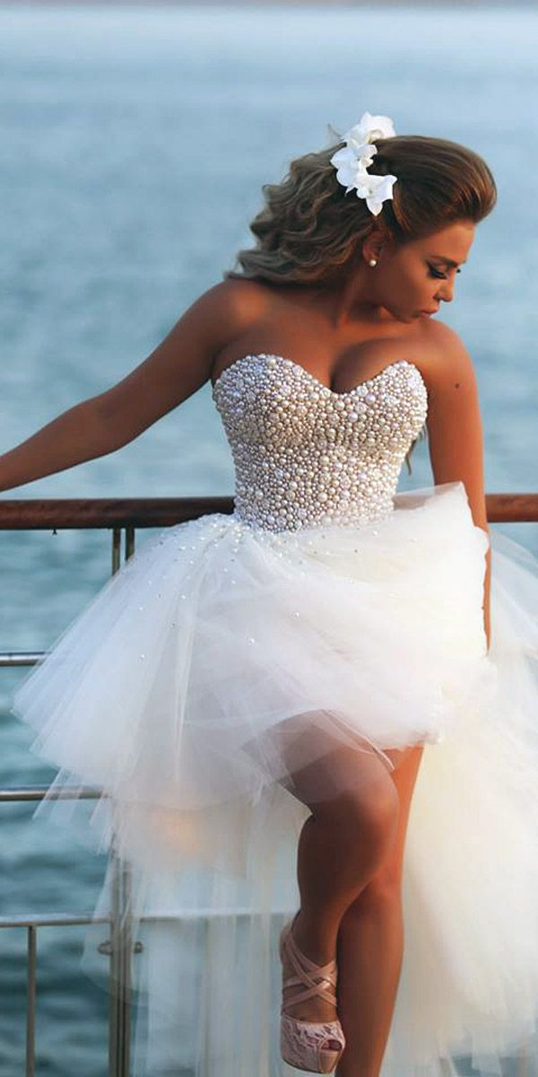 Top 15 High Low Wedding Dresses ❤ See more: http://www.weddingforward.com/high-low-wedding-dresses/ #weddings