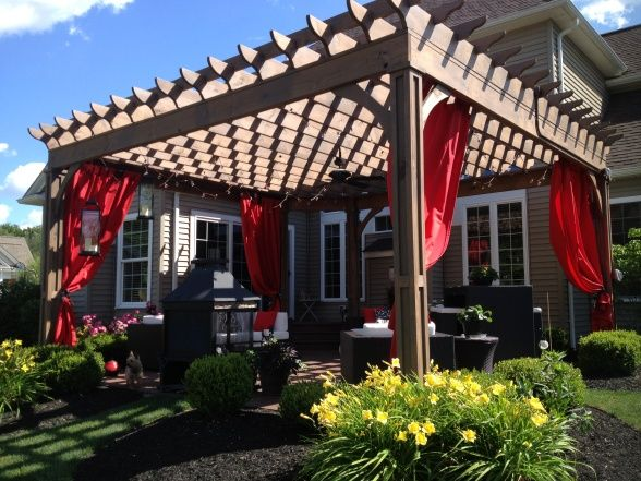 Relaxing Pergola...outdoor curtains, cooling outdoor ceiling fan, water fountain...Nice :)