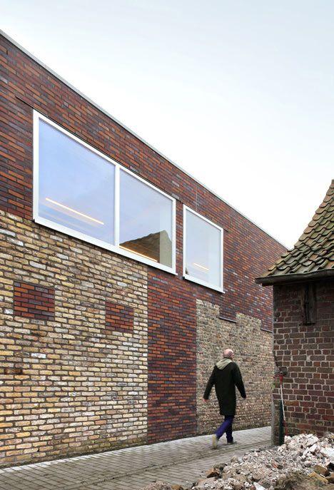 Brick infill and extension of an old building, Community Centre Westvleteren by Atelier Tom Vanhee, via Dezeen