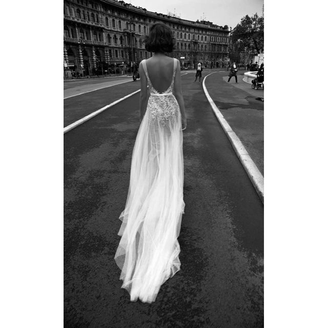 Liz Martinez couture bridal gown. With a ballerina-style bare back and loose, soft tulle flowing endlessly from a nipped waist, we are loving the effortless freedom feels of this couture gown. Channelling summer ease, breath and confidence, with a high-end elegance.