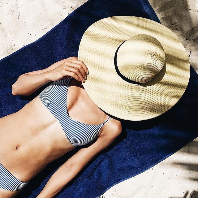 Hitting snooze. (Shop the shoulder tie French bikini top and bikini bottom in seersucker via the link in our bio.) cc: @tv_like_the_appliance #regram #sunnysomewhere