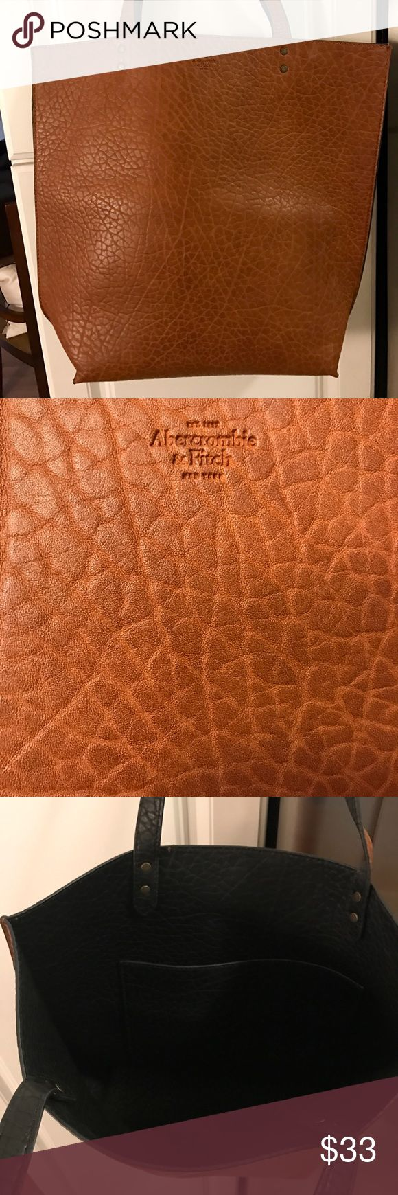 Abercrombie & Fitch Camel Tote Perfect as an everyday bag! Beautiful camel color tote, sturdy enough for iPad, laptop or some books. ✨ no wear. Only used once. Inside has a small side compartment. 🌺 Abercrombie & Fitch Bags Totes
