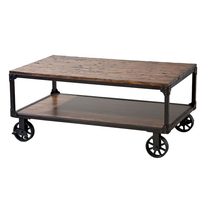 Rectangle rolling cart table with one lower storage shelf. Rich reclaimed wood finish. Plank style top with black metal frame. Riveted corner brackets and industrial style wheels .