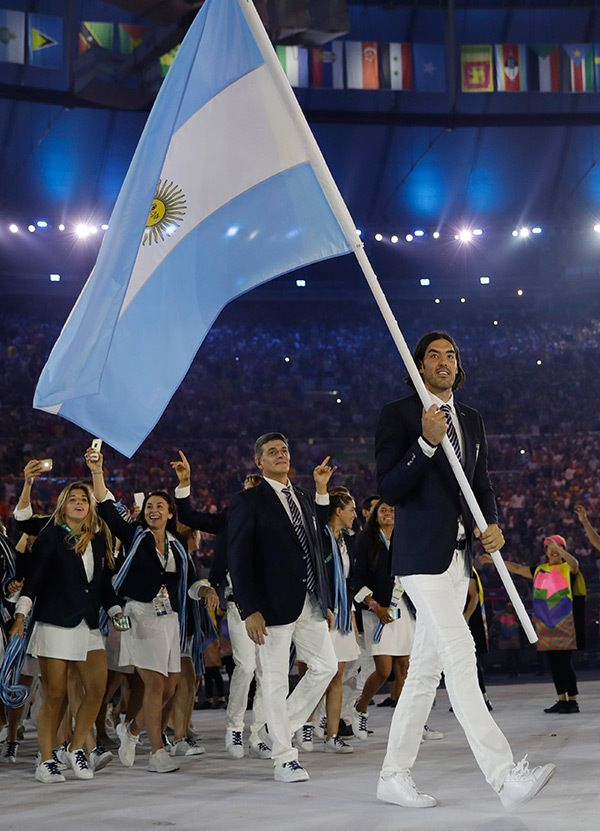Luis Scola carries the flag of Argentina during the opening ceremony for the 2016 Summer Olympics in Rio de Janeiro, Brazil, Friday, Aug. 5, 2016.